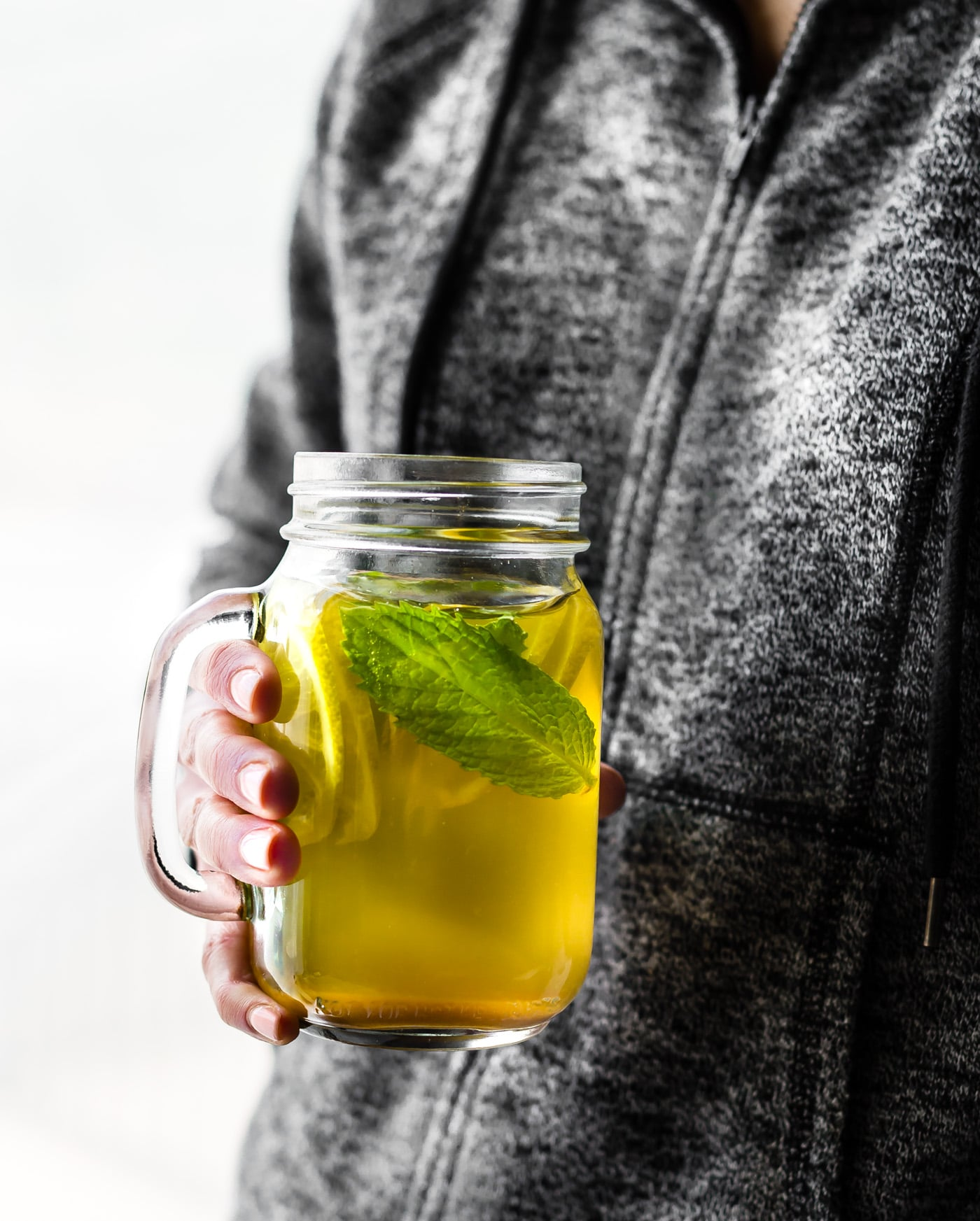 This Turmeric Ginger Lemonade with fresh Mint is great for fighting fatigue and reducing inflammation in the body. It's quick to make, naturally sweetened, and super refreshing! A homemade lemonade with a hint of spice, tartness, and Zing! Vegan, paleo, and AMAZING!
