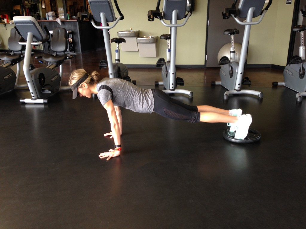 Plank walk with weights - 1 of 3 creative core exercises for balance and strength.