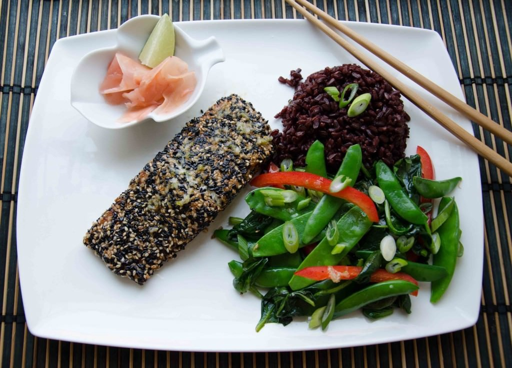 Sesame crusted salmon with ginger garlic dressing. A refreshing ginger dressing compliments this Asian Style Salmon! Perfect as we transition into spring! Easy to make, full of omegas, and of course, gluten free!. Paleo friendly