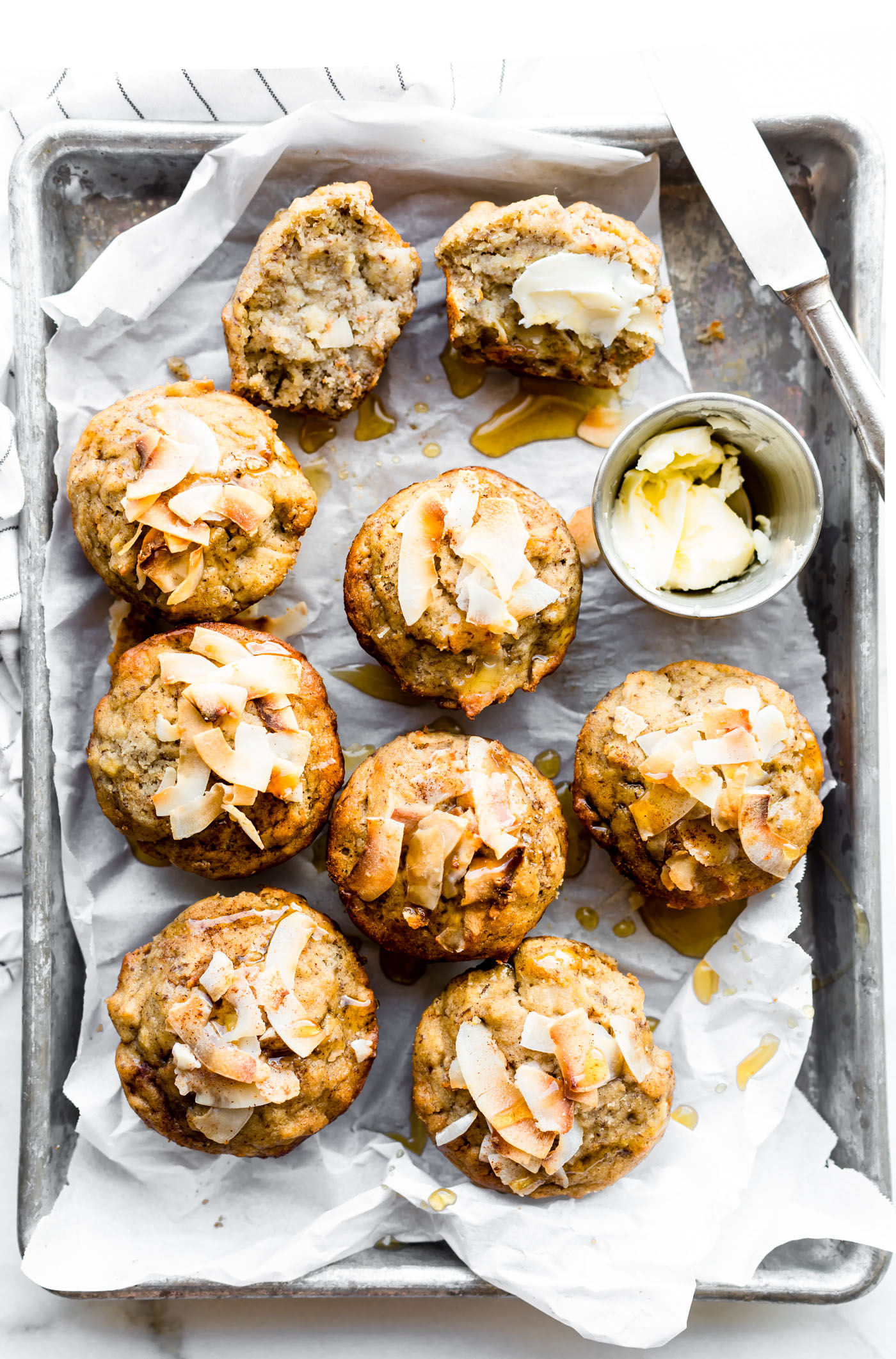 Lightly Sweetened Paleo Banana Bread Muffins with Toasted Coconut. These Banana Muffins are quick to make and delicious! Refinedsugar free, soft, fluffy, and addicting.