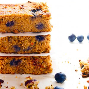 Blueberry Carrot Cake Breakfast Bars. When Summer and Fall baking collide, you get this! A mighty tasty breakfast bar with fresh berries, granola, and carrot spice! Made with gluten free ingredients, natural sugars, and a little extra protein.