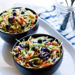 Perfectly Creamy and Tart Broccoli Slaw Salad with Blueberries. It's backed with antioxidants and probiotics! The tang comes from using a kefir and greek yogurt blend instead of mayo. Which also makes it healthy and gut friendly. Super clean eating with great flavor!