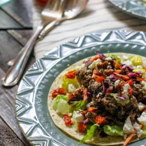Gluten Free Greek Tacos with Lamb! Lamb is a great alternative to your ordinary beef filling for tacos! Easy to make in the slower cooker, healthy and a great source of protein, plus it makes a delicious healthy meal when paired with a crumbled feta and salad topping! Serve on gluten free tortillas or corn tortillas!