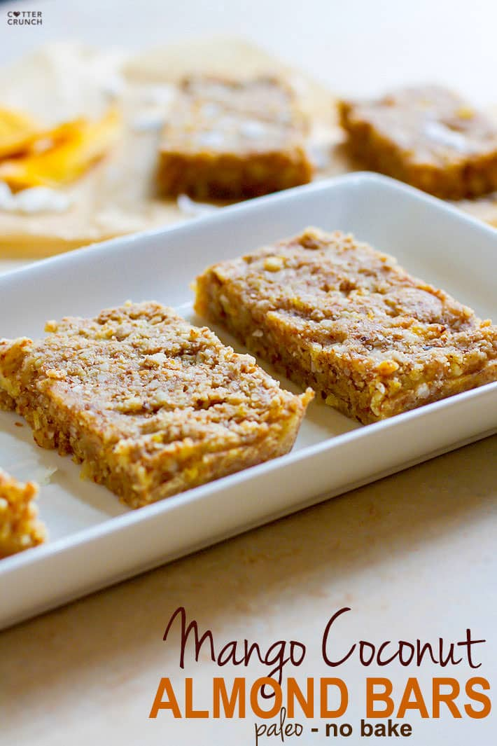Paleo Mango Coconut Almond Protein Bars! These no bake bars are balanced with flavor, easy to digest, made with natural sugars, healthy fats, and complete protein. Great for travel, pre/post workout fuel, breakfast, and healthy snacking!
