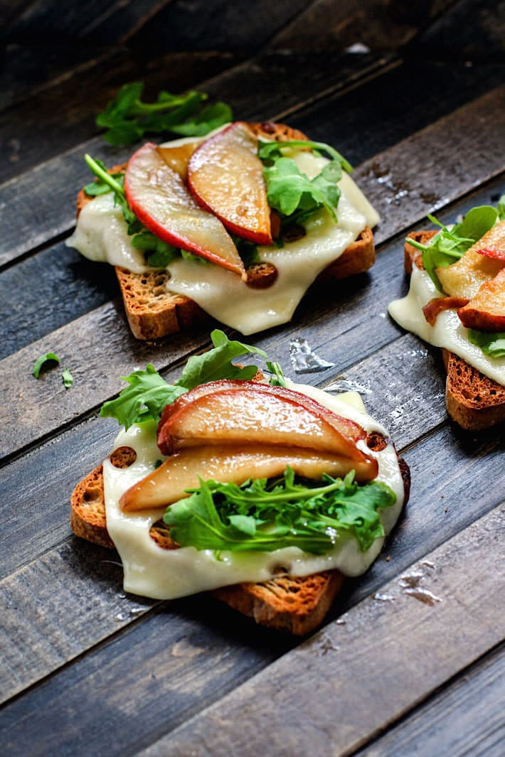 Honey Balsamic-glazed pears with Swiss Cheese and arugula on Gluten Free Rye toast! A delicious vegetarian meal great for a quick lunch, appetizer, or even a post workout recovery meal/snack! Balanced with whole grain gluten free carbs, protein, and healthy fats!