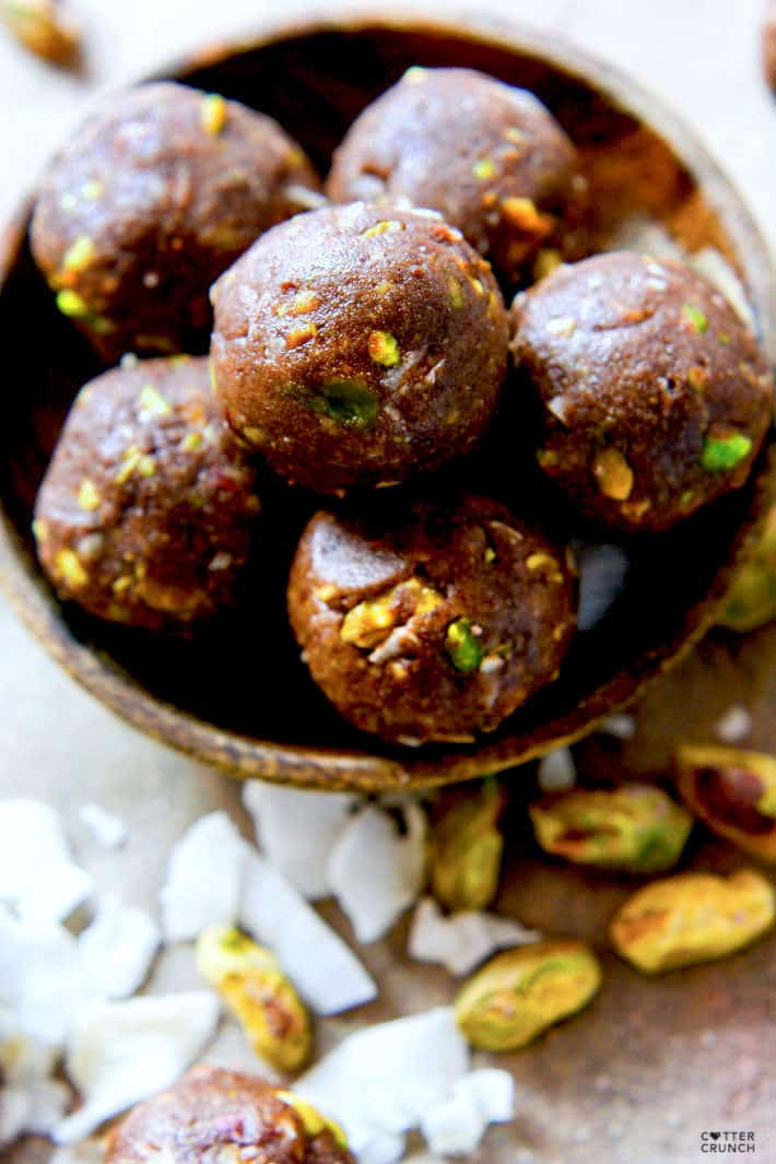 Paleo and Vegan friendly Dark Chocolate Coconut Pistachio bites! A crunchy, lightly sweet, delicious snack BITE that requires no baking! These little chocolate bites are naturally sweetened and packed healthy fats!
