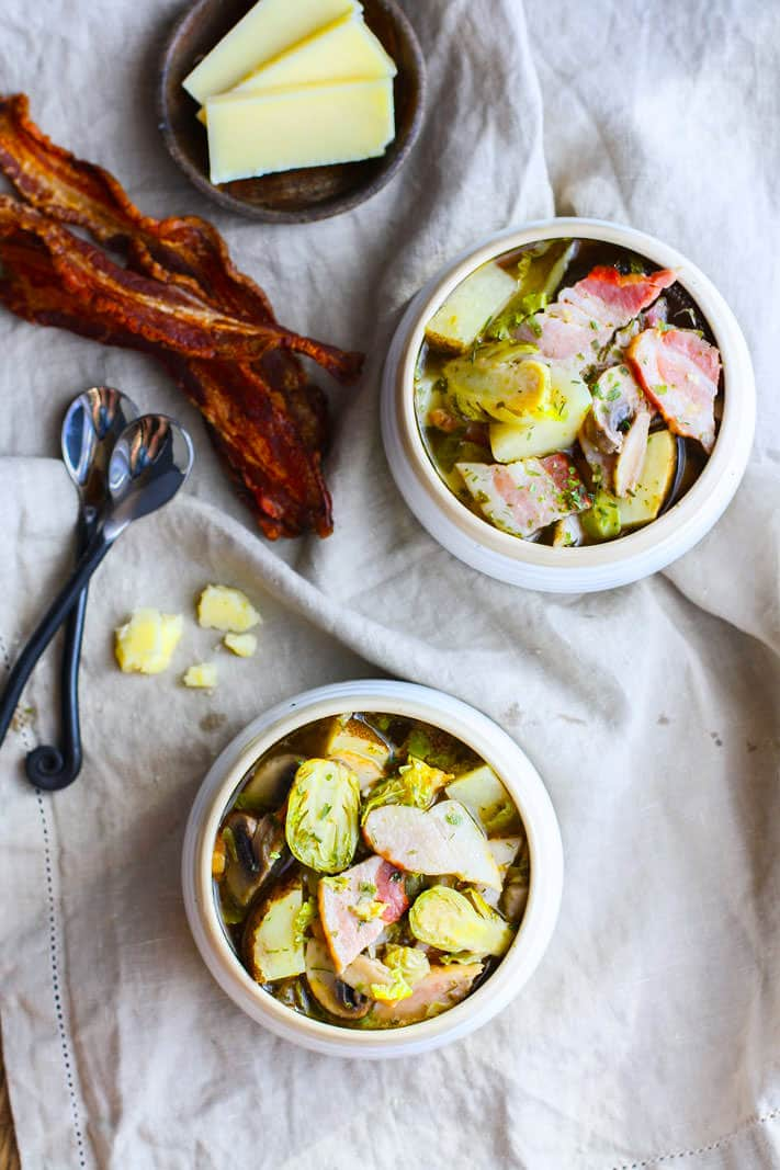 This smoked bacon veggie soup recipe is gluten free, grain free, Paleo friendly, and packed with simple, wholesome ingredients and flavor. Easy to make in a slow cooker or the oven! @cottercrunch