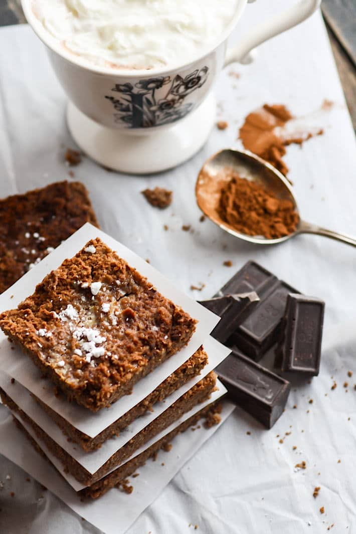Grain Free Hot Chocolate Brownies! Basically hot cocoa in bar and super delicious! These grain free hot chocolate brownies can me made two ways; rich milk chocolate or lower sugar with dark chocolate and an egg free option! Either way, they are great to pair with cup of coffee, steamer, or hot chocolate of course! Ready in less than an hour. #cottercrunch