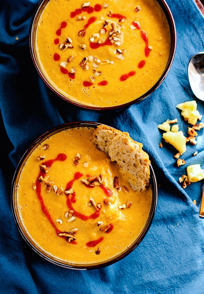 Vegan Persimmon and Butternut Squash Soup! A creamy, sweet yet smokey butternut squash soup recipe with the addition of Persimmon and it's amazing health perks! Paleo, Gluten free, dairy free, and super easy to make! This is one immunity boosting delicious soup!
