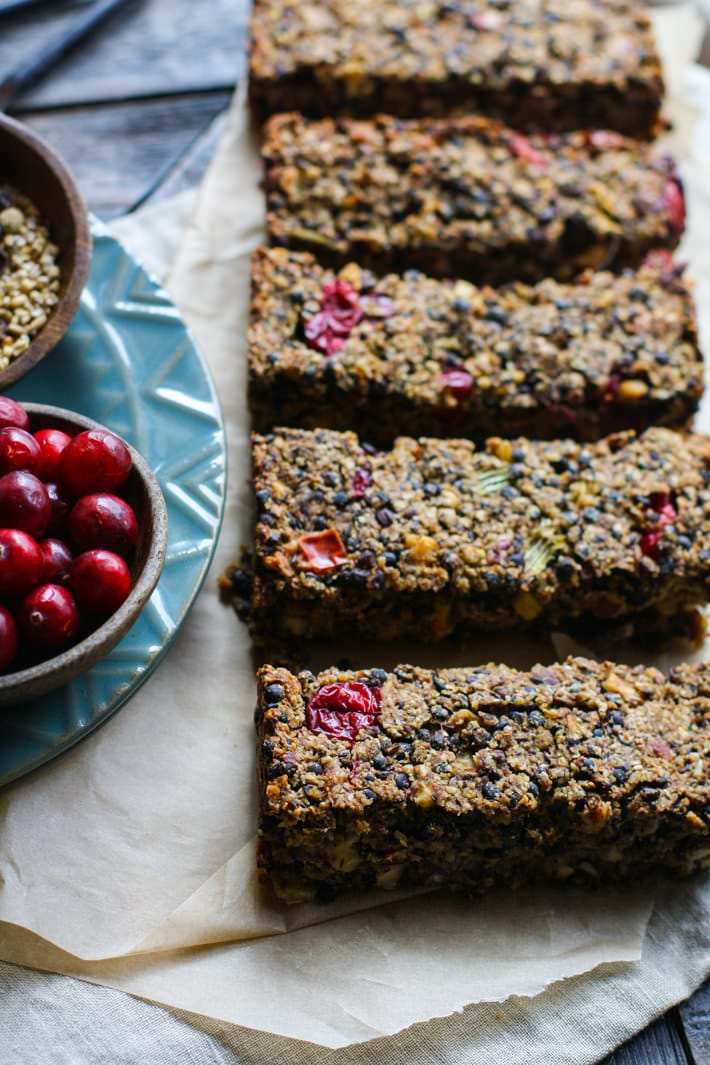 Gluten free Vegan Cranberry Maple Lentil loaf! A great dish to add to your Thanksgiving or Christmas table.  Lentils, fresh cranberries, nuts, and sautéed veggies all baked up into one healthy and delicious lentil loaf. The Maple glaze topping makes it even more flavorful. Super easy to make as a side dish or a main dish.