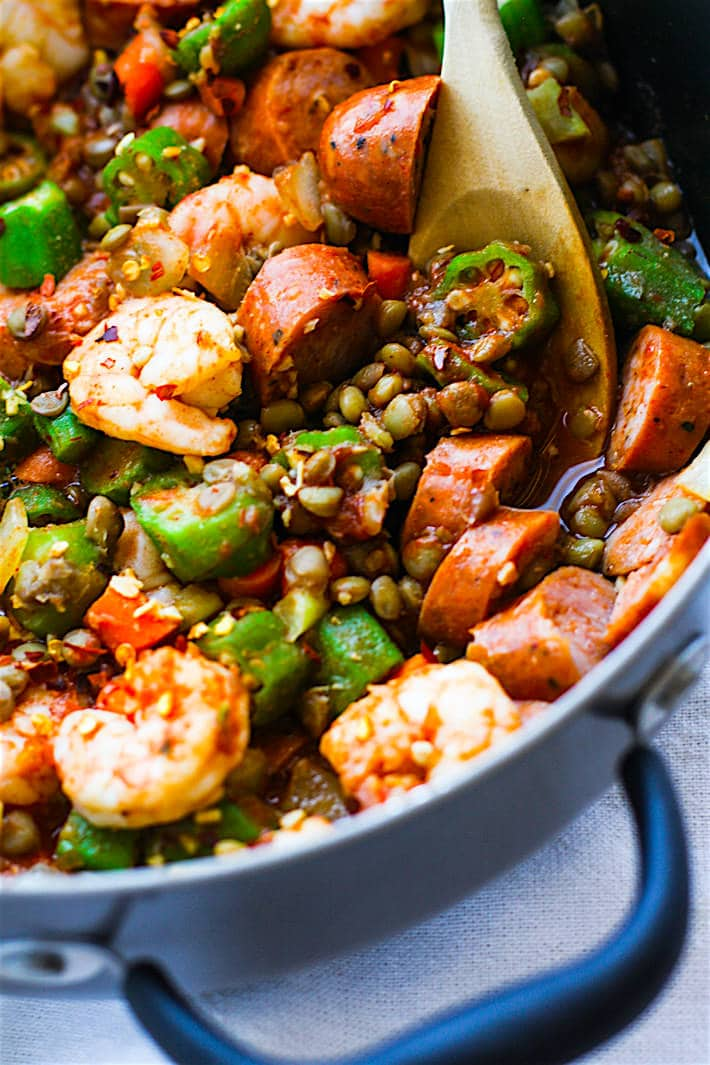 Healthy southern comfort food! One Pot Shrimp Jambalaya Lentil Bowls! A grain free Healthy Southern Food Mash up! A fun and healthy twist on classic Jambalaya and shrimp gumbo combined together to make one tasty bowl. It's an easy one pot meal for a family, potlucks, or even to make ahead and freeze for later!
