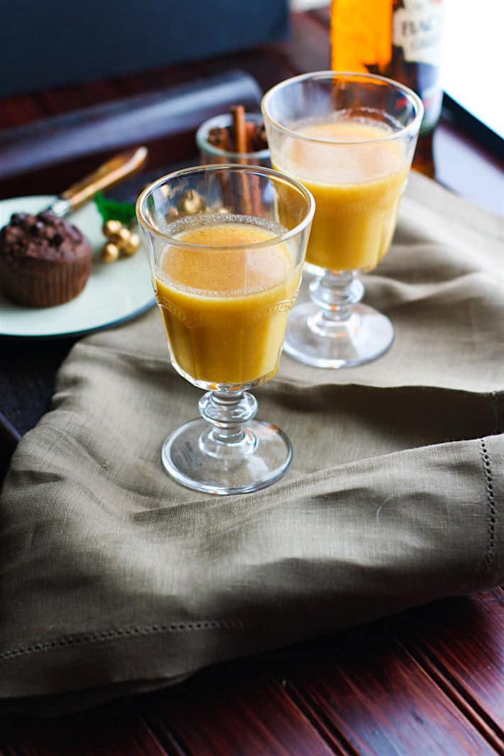 Spiced pineapple rum hot toddy is made with natural sugars and a touch of cinnamon and coconut milk for healthier Holiday sipping! Perfect for a cozy night or for parties!