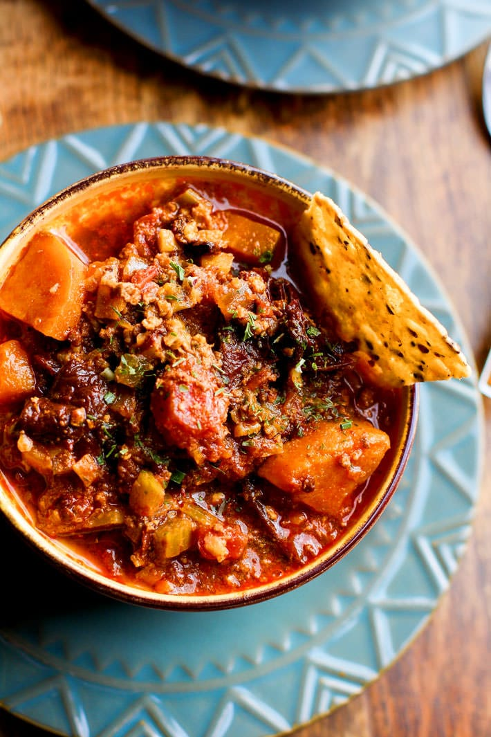 pCrock Pot Paleo Sweet Potato Chipotle Chili! This chipotle Chili recipe is healthy but hearty, and has a kick of spice! Made with simple ingredients you probably already have in your fridge! A gluten free and paleo friendly chili made easy in the crock pot so you can be ready to serve with little effort .