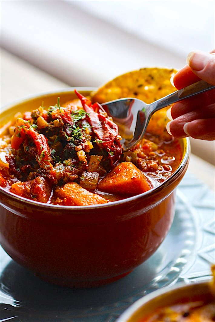 Crock Pot Paleo Sweet Potato Chipotle Chili! This chipotle Chili recipe is healthy but hearty, and has a kick of spice! Made with simple ingredients you probably already have in your fridge! A gluten free and paleo friendly chili made easy in the crock pot so you can be ready to serve with little effort . cottercrunch.com