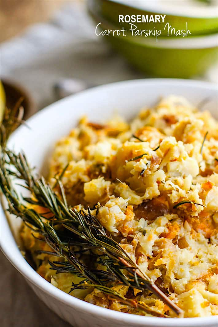 Paleo Rosemary Carrot Parsnip Mash. A healthy grain free and gluten free side dish for your holiday table! Made simple and easy in the crock pot with real ingredients you have in your pantry! No stress and no mess!