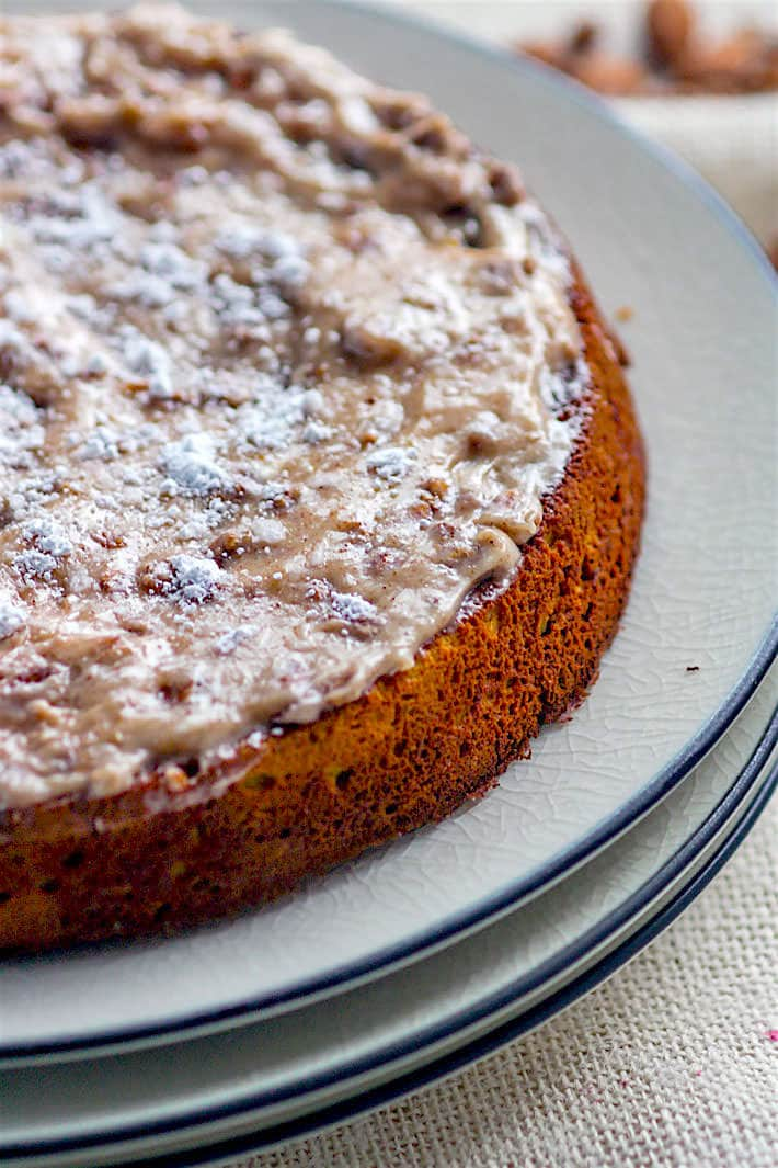 Grain Free White Chocolate Spiced Almond Cake! A healthy holiday twist on the classic almond cake! Cinnamon Spiced almond cake with melted white chocolate and a cinnamon cream cheese topping.Taste so decadent but is actually pretty healthy and easy to make.