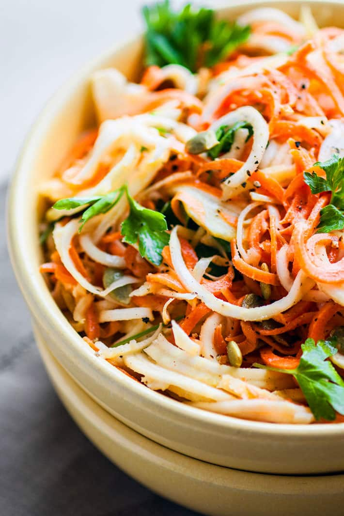 Easy Carrot Celeriac Spiralized Salad! A light spiralized salad that is simple and delicious! Ready in under 30 minutes. Paleo, vegan, and low carb too!