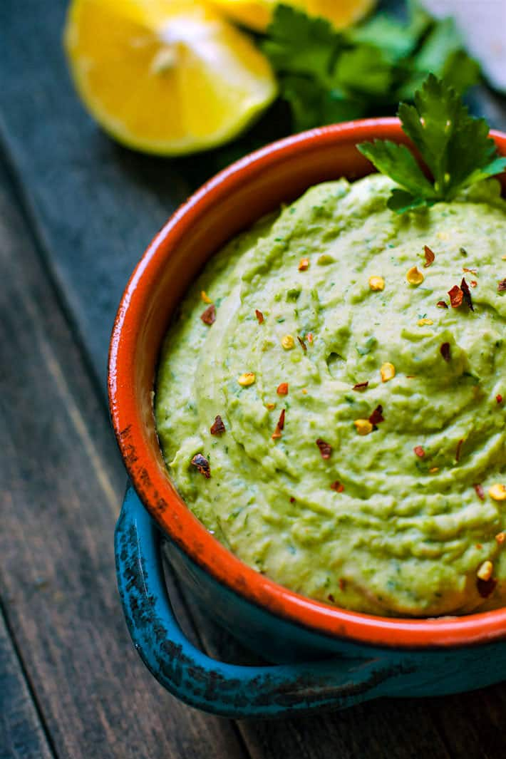 Easy Chimichurri White Bean Hummus. A healthy gluten free white bean hummus that is bursting with flavor and color! So simple to make, vegan friendly, and a total crowd pleaser appetizer or snack!