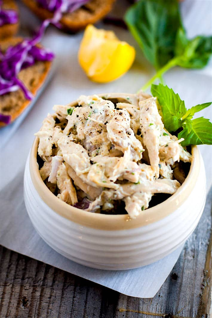 Tangy Crock Pot Chicken Salad on open faced sandwich sliders! These crock pot chicken recipe is healthy, easy, mayo free, and egg free ! So good for a quick meal, light lunch, appetizer, or food prep for the week