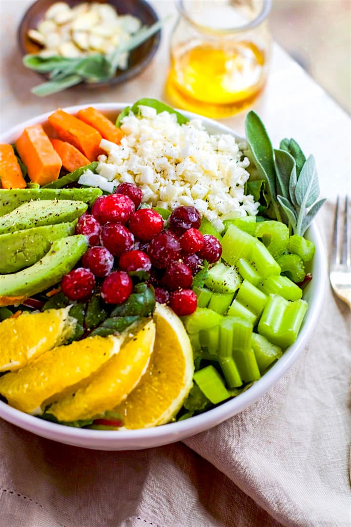 Winter's Bounty Paleo Cobb Salad! Take advantage of seasonal produce and make this healthy Paleo Cobb Salad that's fit for a king! It's packed with, flavor, protein, healthy fats, and LOADS of seasonal fruits and veggies! You'll love how easy and delicious is to make for one or for the whole family. Option to make vegan friendly as well.