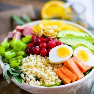 Winter's Bounty Paleo Cobb Salad! Take advantage of seasonal produce and make this healthy Paleo Cobb Salad fit for a king! It's packed with, flavor, protein, healthy fats, and LOADS of seasonal fruits and veggies! You'll love how easy and delicious is to make for one or for the whole family. Easy to make vegan friendly as well.