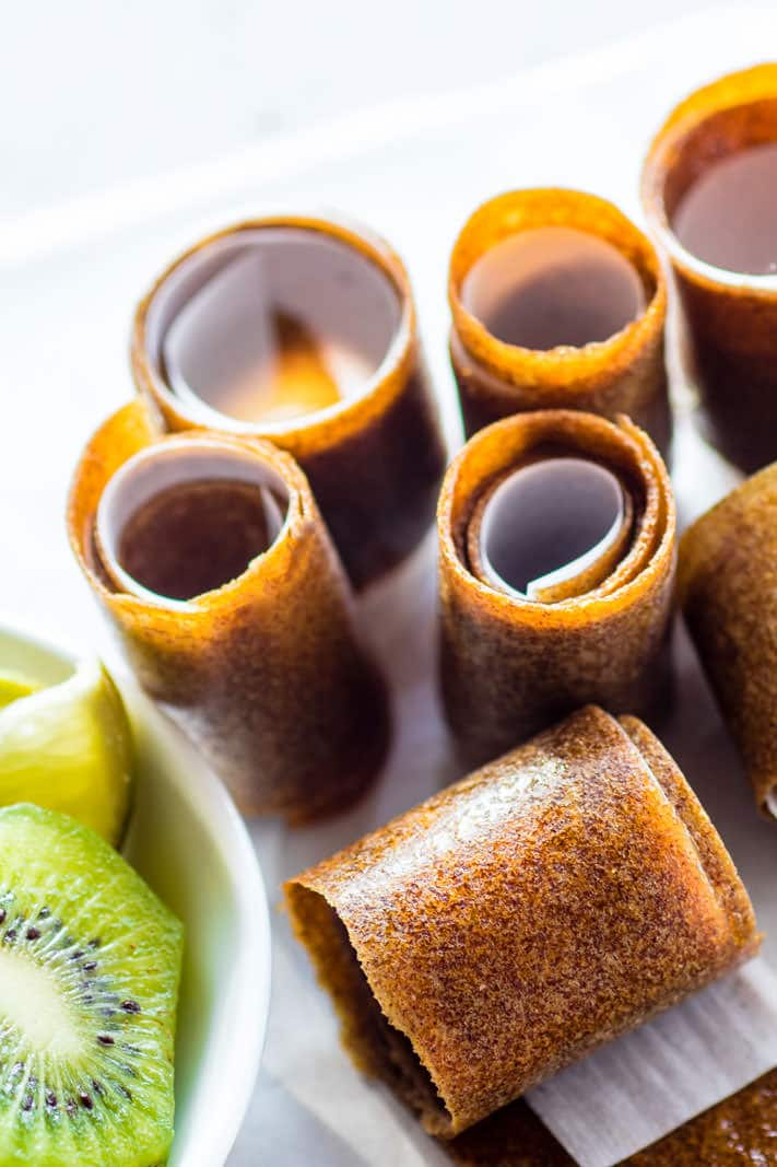 Super Simple and Healthy Citrus Kiwi Pineapple Homemade Fruit Roll Ups! These homemade fruit roll ups are an awesome snack for kids, adults, and active folk who need real food fuel! Homemade fruit rolls ups you can make in the dehydrator or oven. Real fruit based and no additives! PERFECTO!