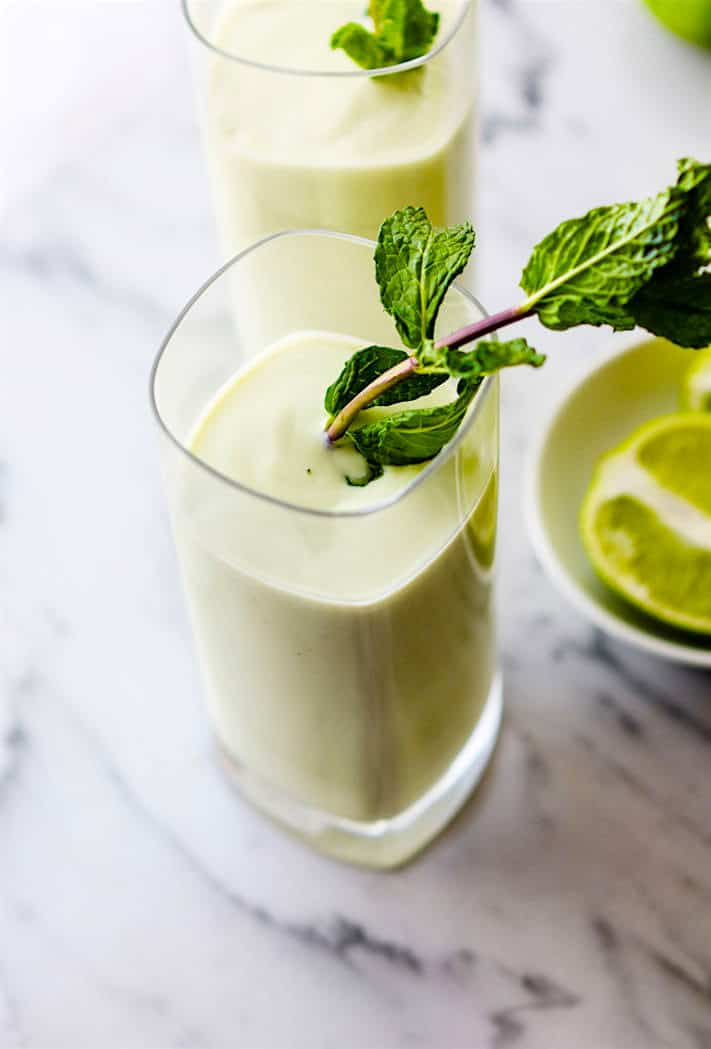 Vegan Creamy Vanilla Coconut Mojito Smoothie plus a Nonalcoholic Fauxjito Option! A delicious and more nutritious cocktail/mocktail you can get on board with. Refreshing coconut mojito smoothie with creamy avocado, vanilla, maple syrup, coconut milk, lime, and mint.