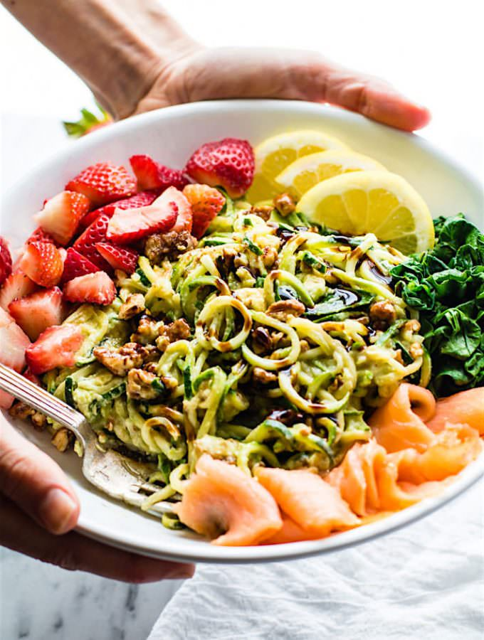 Smoked Salmon and Strawberry Zucchini Noodle Pasta Salad! A healthy lower carb Zucchini noodle pasta salad bowl with a creamy avocado sauce and tasty mix ins! Perfect for a spring or summer lunch or side dish.