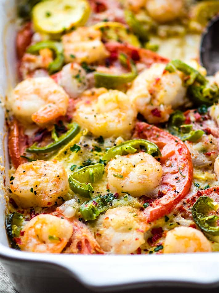 EASY Jalapeño Shrimp Veggie Bake! This Spicy Jalapeño Veggie bake is low carb, grain free, and simple to make in under an hour! Seasonal vegetables, lean protein, herbs, and spices all baked to perfection. A better for you gluten free VEGGIE bake/casserole that's a total crowd pleaser.