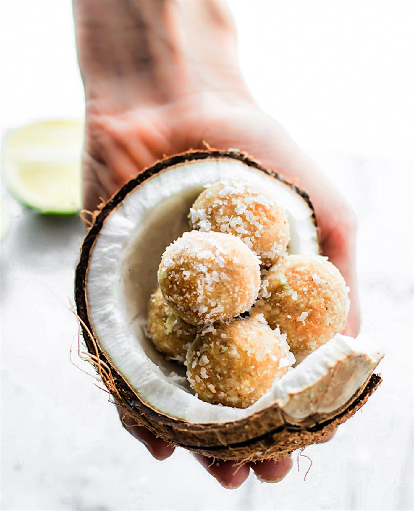 No Bake Coconut Margarita Bites! Super simple no bake coconut margarita treats in dessert bite form! These bites are naturally gluten free, paleo friendly, and vegan! Bites that actually taste like a frozen margarita with natural lime and coconut flavors.