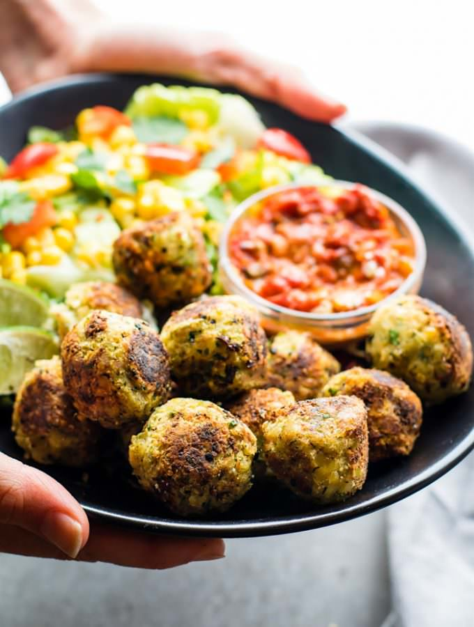 Healthy Mexican Vegan Falafel Bites! These Vegan Falafel bites are super easy to make with just a can of chickpeas, spices, veggies, jalapeño, and gluten free flour. No eggs needed.  Great for a quick finger food meal or a wholesome appetizer!