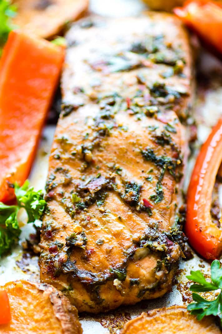 Easy Sheet Pan Jerk Salmon with Veggies! Flavorful Jerk salmon recipe with seasonal veggies baked all on one sheet pan. A wholesome protein packed one pan meal that nourishes the whole family! Not to mention EASY cleanup! Yes!