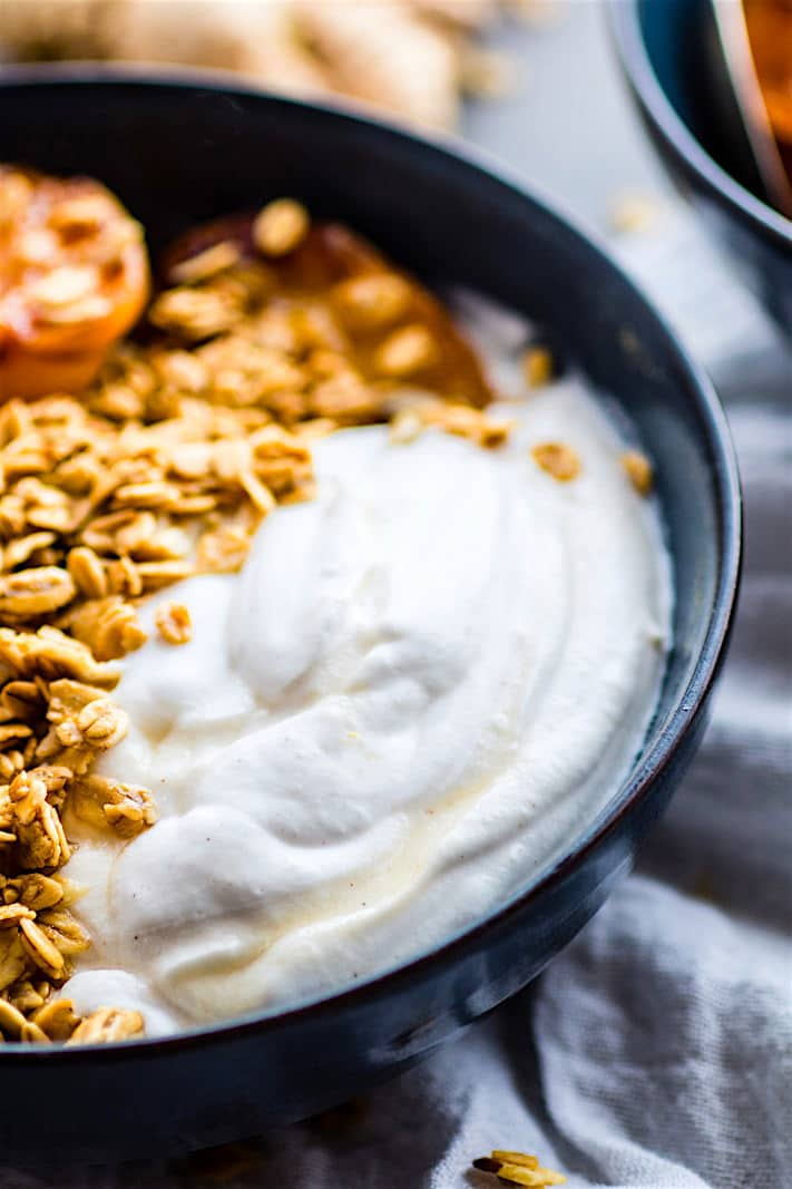 Gluten Free Char-grilled apricot parfait dessert bowls! These dessert bowls are great for dessert or breakfast. A light and simple dessert that's layered across with glazed grilled apricots, whipped coconut cream, and wholesome granola. (dairy free, vegan friendly)