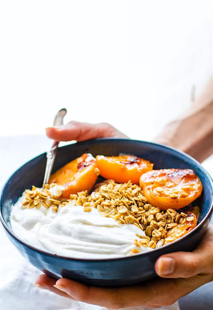 Gluten Free Char-grilled apricot parfait dessert bowls! These dessert bowls are great for a dessert  or a breakfast. A light and simple dessert that's layered with glazed grilled apricots, whipped coconut cream, and wholesome granola. Vegan Friendly.