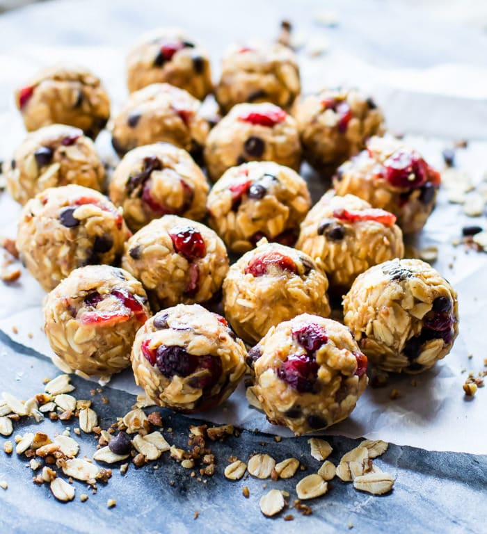 LOADED No Bake Oatmeal Cookie Energy Bites. A gluten free no bake lunchbox treat that's healthy and wholesome. Blended maple glazed nuts, chocolate chips, oats, peanut butter, and cranberries all combined to taste just like oatmeal cookies but in energy bite form. Real food fuel to feed you and your family!