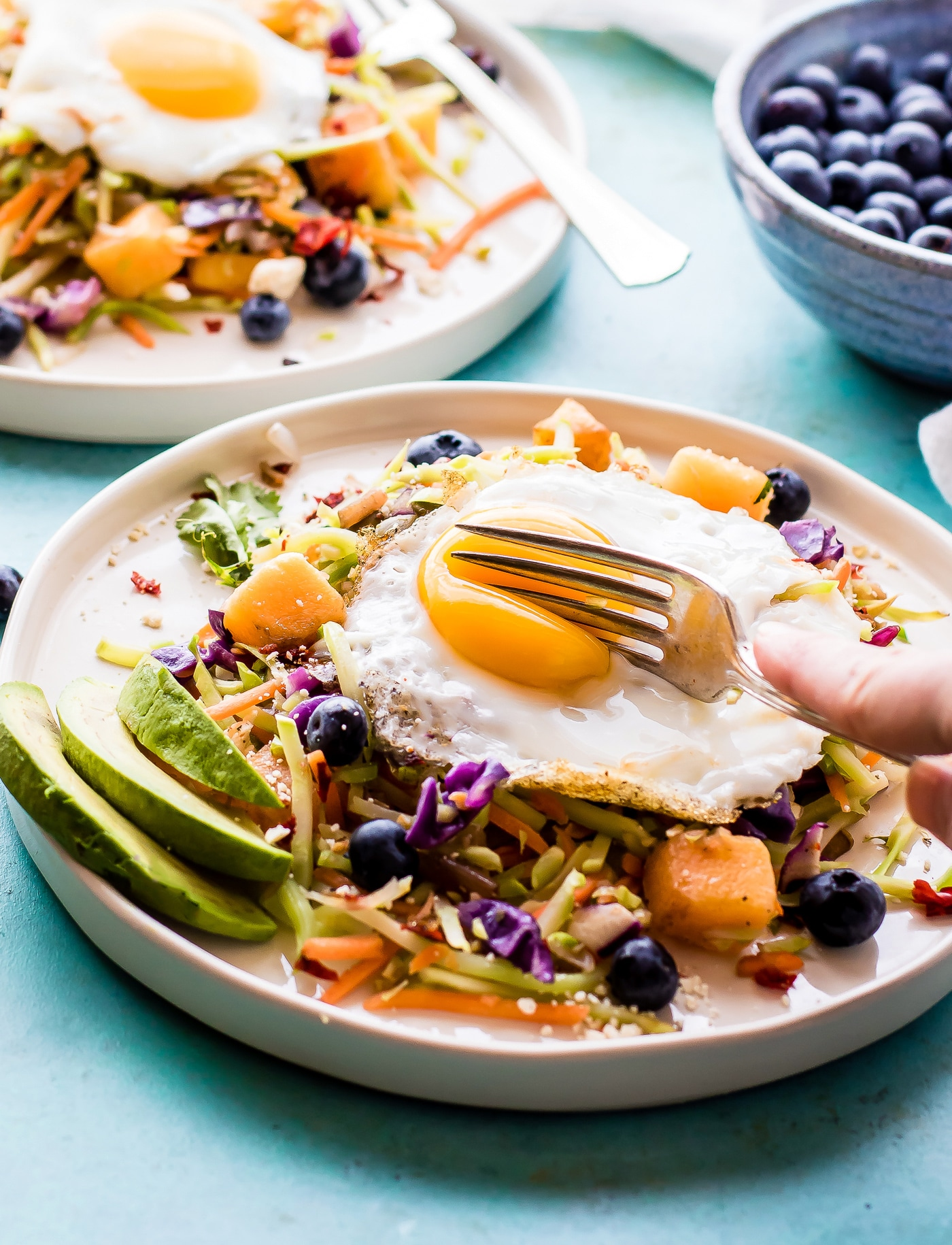 Breakfast salad to start the day! A nourishing warm Paleo meal with broccoli slaw, squash, berries, and fried eggs. A breakfast salad worth waking up for!