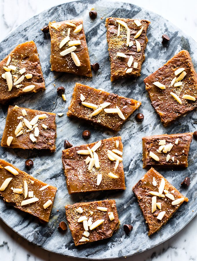 Paleo Toffee made with just 4 simple ingredients and EASY to make! Real butter, maple syrup, dark chocolate, and more. The perfect Maple Paleo Toffee treat to get you through the Holidays... okay it's just good ANYTIME!  Healthier gluten free treats to love and share.
