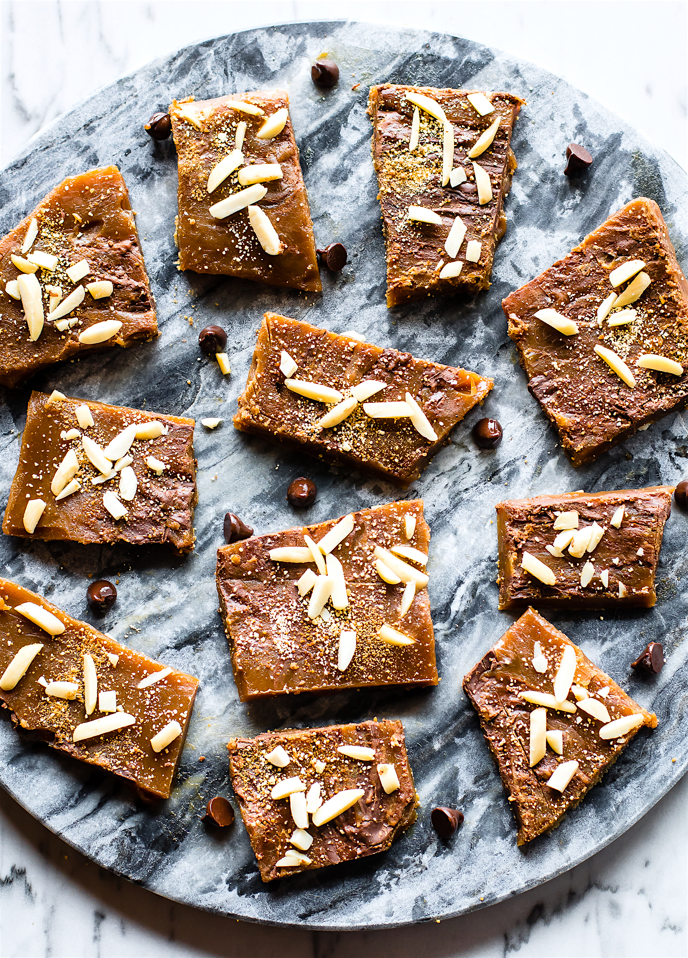 Paleo Toffee made with just 5 simple ingredients, plus your favorite topping. EASY to make with real butter, maple syrup, dark chocolate, and more. The perfect Maple Paleo Toffee treat to get you through the Holidays... okay it's just good ANYTIME! Healthier gluten free treats to love and share.