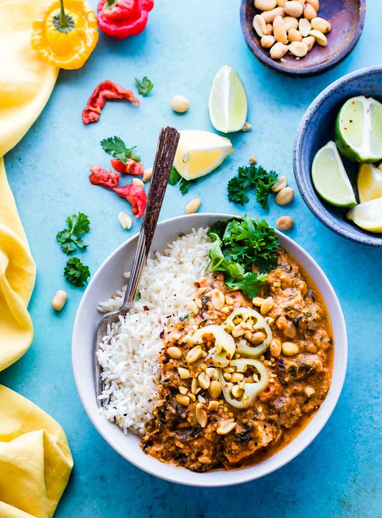 Fiery Crock Pot West African Peanut Stew! A wholesome gluten free stew that's packed with nourishment and warming flavors. This African Peanut Stew is great over rice and feeds the whole family! Freezer friendly, dairy free, and made with healthy staple ingredients!