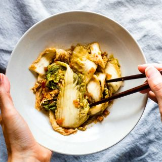 This EASY kimchi recipe has a fusion of Asian and Southwest flavors. A spicy, tangy, and oh, so easy homemade kimchi recipe! This paleo kimchi recipe takes very little time to prep and make. The hardest part is waiting for it to ferment. A vegan friendly healthy side dish. This is the BEST kimchi I've ever tasted!