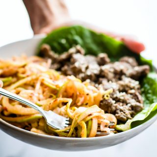 "Spiralized Apple ""kimchi"" salad with Garlic Beef! This healthy Asian inspired spiralized apple salad makes a quick kimchi substitute. A 20 minute Paleo meal."