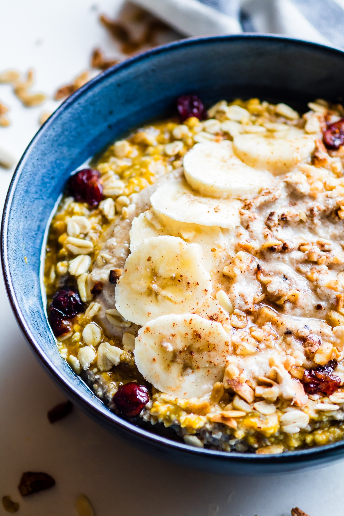 Pumpkin Overnight Oats with Cinnamon Cashew Cream and cranberry nut topping! A vegan pumpkin overnight oats recipe perfect for those Fall breakfasts. I might have snuck in some extra pumpkin spice too! Gluten free, healthy, easy, and oh so nourishing!