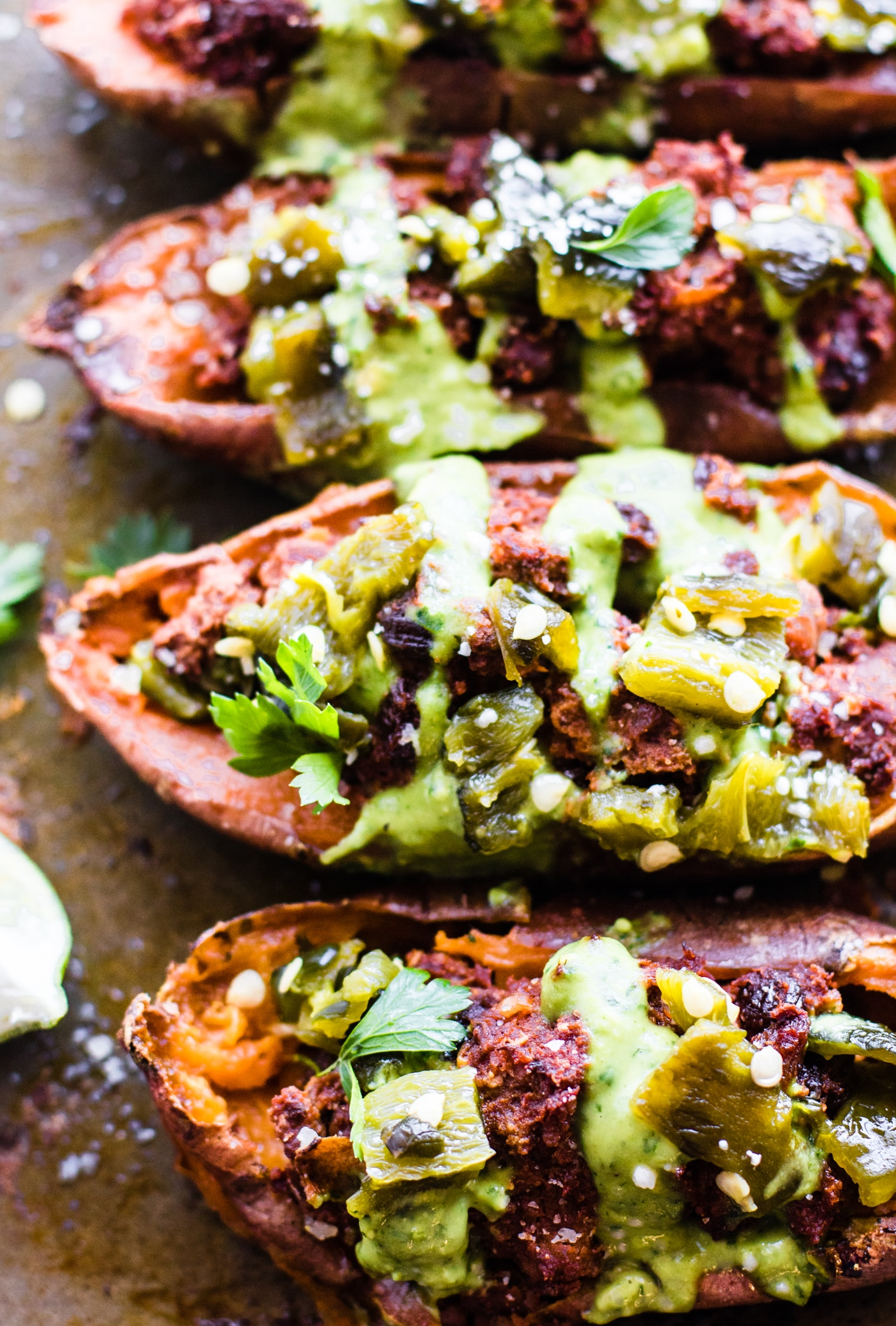 Ancho Beef Chili stuffed & baked into Sweet Potato Skins for an easy Paleo appetizer or meal! Healthy Ancho Beef Chili sweet potato skins to feed a crowd.