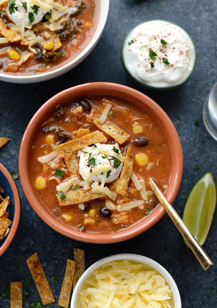 Crock-Pot Chicken Tortilla Soup with Kale. Chicken Tortilla Soup never got easier AND HEALTHIER! Throw everything in your crock-pot and you've got dinner ready before you know it!