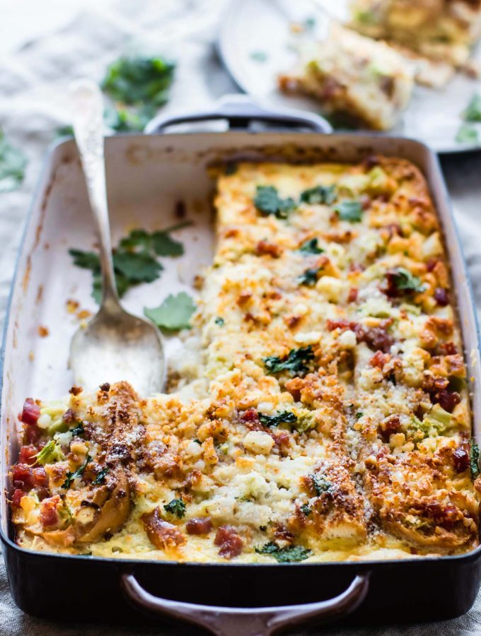 A Gluten Free French Bread Ham Breakfast Strata recipe that's easy-to-follow and will please everyone! Yes, it does exist! A Breakfast Casserole you can make ahead or bake in 30 minutes. Layers of breakfast staples like eggs, French bread, ham, veggies, and more. Great for a gluten free Brunch or Holiday table!