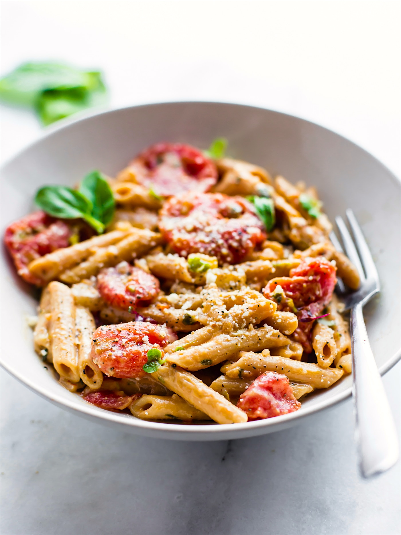A Creamy Tomato Gluten Free Penne Pasta dish that's ready in 25 minutes, delicious, and dairy free. This gluten free penne pasta recipe is perfect for those who are new to gluten free or are looking for a lighter pasta dish alternative! It's protein packed vegetarian pasta with a healthy amount of plant based Iron.