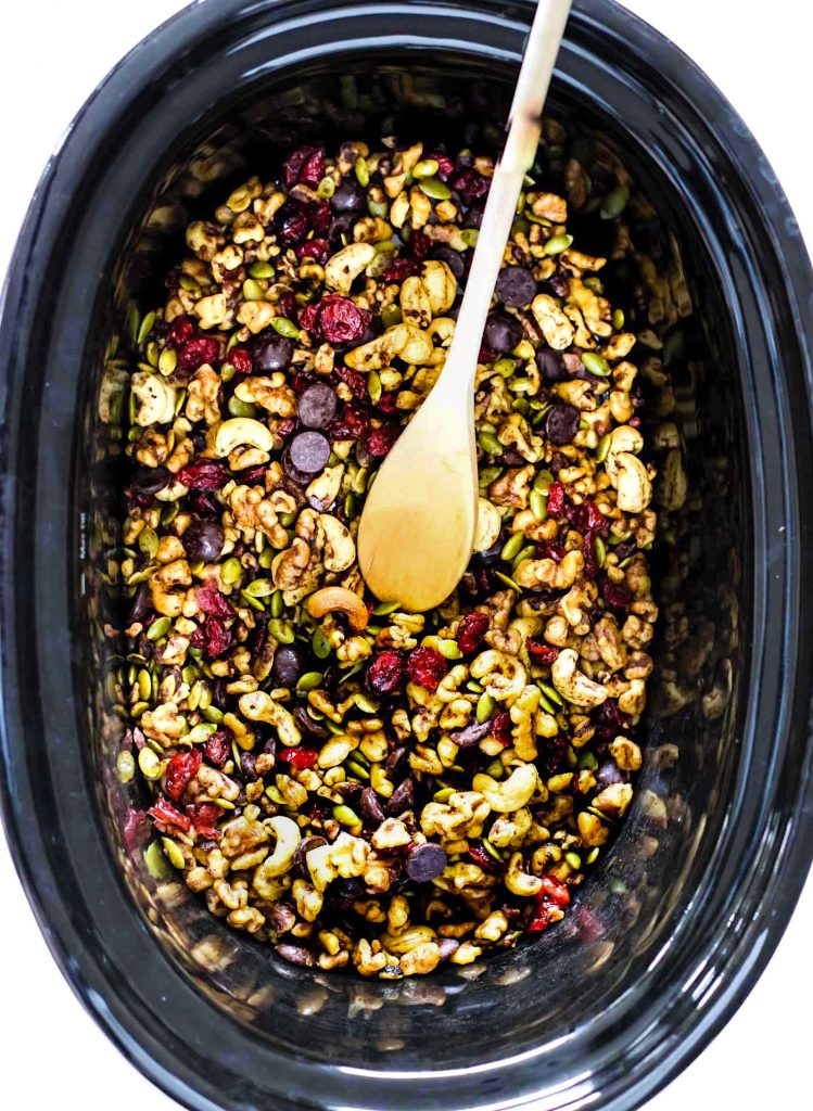 A pumpkin spice trail mix easy to make in slow cooker and a great Holiday gift! A paleo and vegan trail mix with dark chocolate, cranberries, nuts, spices!