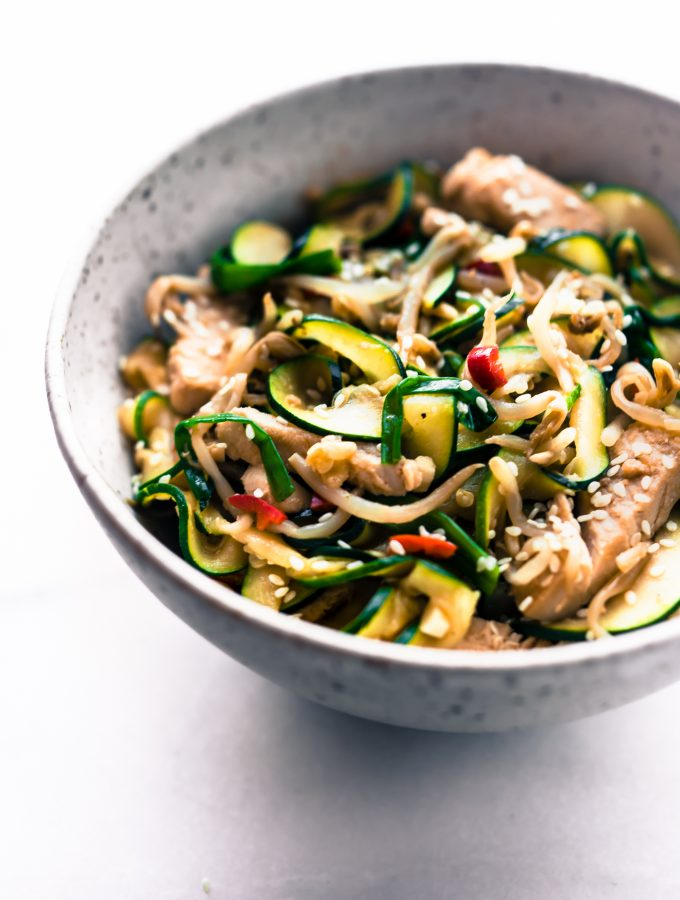 A Turkey Chow Fun recipe made with tamari zoodles! This spiralized zucchini turkey chow fun stir fry is light, naturally gluten free, and lower in carbs. A chow fun recipe that puts those leftover veggies and Turkey to use. Quick to make and delicious!