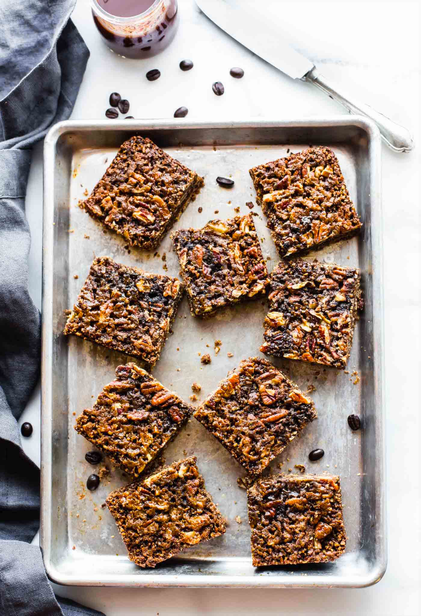 A Vegan Coffee Pecan Pie Bars recipes that's easy to make and Paleo. Your favorite holiday dessert in smaller bar form, and lighter. Simple, delicious, and will PERK you up in no time.