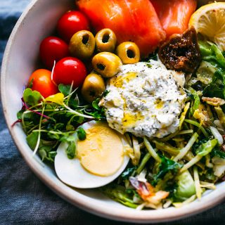 This warm greens salad with salmon and whipped goat cheese is a nourishing low carb, gluten-free recipe that satisfies your hunger | @cottercrunch